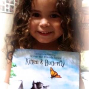 Picture of adorable child holding one of Aviva Gittle's books.